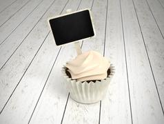 gift cupcake with blank chalkboard signboard label on white wood - stock illustration