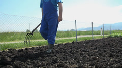 Gardener walking on the manure in close up Stock Footage