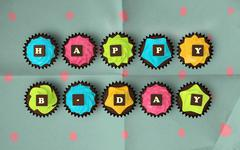 happy birthday cupcakes isolated on vintage background - stock illustration