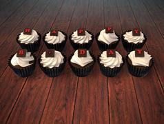 Happy birthday cupcakes on dark wooden background Stock Illustration