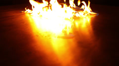 Fire patches in background dancing on reflective surface Stock Footage