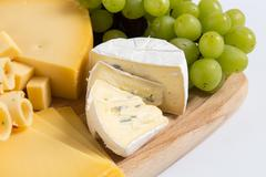 cheese plate variation isolated white - stock photo