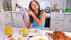 Woman applying make up and breakfast. Stock Footage