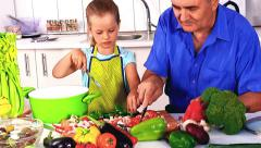 Stock Video Footage of Family with child cooking at kitchen.