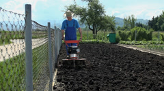 Man cultivating land in slow motion - stock footage