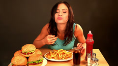 Woman eating fast food. - stock footage