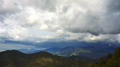 4K timelapse of rain clouds billowing over beautiful mountain landscape Stock Footage