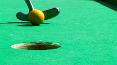 Golf stick and ball on green grass . Stock Footage