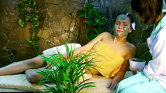 girl having clay body mask apply by beautician. - stock footage