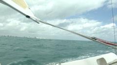 Small sailing boat navigating - stock footage