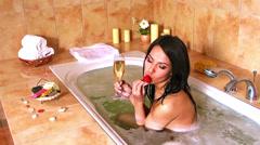 Young woman take bubble bath Stock Footage