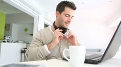 Man with a laptop and headset on Stock Footage