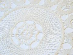 Handmade crochetted doily, closeup - stock photo