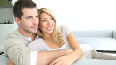 Couple relaxing in sofa and looking away Stock Footage