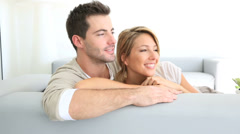 couple relaxing in sofa and looking away - stock footage
