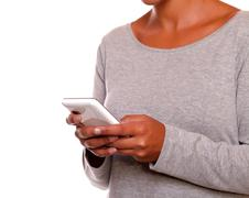 One person sending a message by mobile phone - stock photo