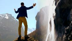 man raising arms. leisure activity. waterfall. male person. - stock footage