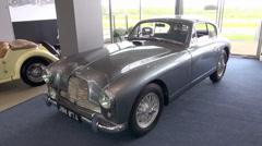 Silver Vintage Aston Martin sports car Stock Footage