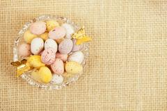 Easter chocolate speckled eggs in bowl  on hessian table Stock Photos