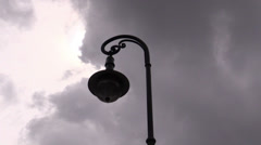 Lantern against floating clouds Stock Footage