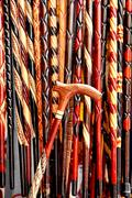 Hand made wooden walking sticks as background Stock Photos