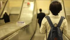 Boy on Automatic Stairs, London Tube - stock footage