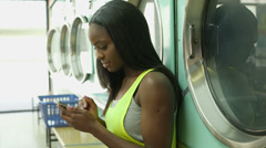 MS Two Young Women use the Launderette Stock Footage