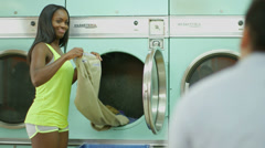 MLS A Young Man and a Young Woman meet in a Launderette Stock Footage