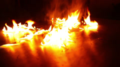 Fire close up dancing on reflective surface Stock Footage