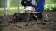 Stock Video Footage of Motorized cultivator mixing fresh soil close up slow motion