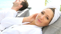 Couple relaxing in luxury spa resort Stock Footage