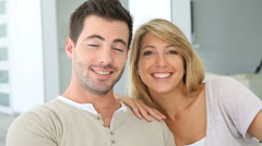 cheerful couple talking to camera - stock footage