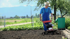 Blue-collar man cultivating land in slow motion - stock footage