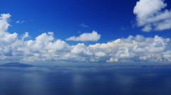 Cloudscape time-lapse, white clouds running across the blue sky. Stock Footage