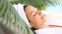 Woman relaxing outside spa resort Stock Footage