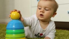 Baby boy playing with a ball Stock Footage