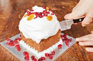 Stock Photo of Cutting christmas cake