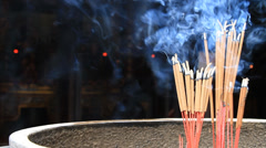 Burning incense at the temple Stock Footage