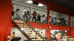 People doing sports, running on machines in fitness, gym. Workout Stock Footage