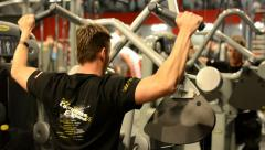 Man strengthens back in fitness or gym. Workout Stock Footage