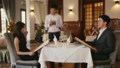 22of26 People dining in hotel restaurant, husband, wife, waiter Stock Footage