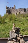 Meerkat - Suricata suricatta on patrol beneath English Castle Stock Photos