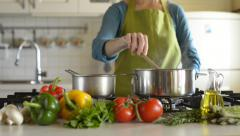 Young woman cooking lunch in the kitchen close up Stock Footage