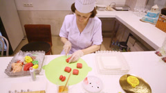 Woman sculpts sweet figures at presentation of new confectionary Stock Footage