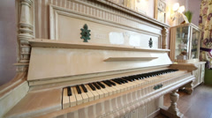 Beautiful piano with painted sheeps in cafe Anderson. Stock Footage