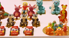 Sweet toys and cartoon characters at press open new cafe Stock Footage