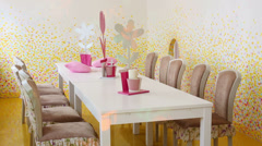 Table and chairs in light room with simple illumination Stock Footage