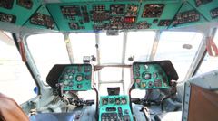 Inside cockpit with multiple control panels in large helicopter - stock footage
