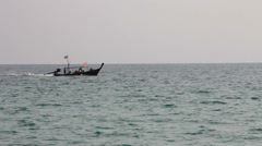 Longtail boat with thai flag, Phuket Stock Footage