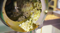 Twisted metal drum of machine for industrial popcorn production Stock Footage